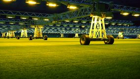 Mobile grow lighting system in sports stadium at night. stock video footage