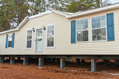 Mobile Home. New mobile home up on blocks after delivery Stock Photo
