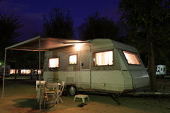 Mobile home on a camping site. European mobile home on a camping site at night royalty free stock images