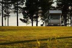 Mobile home on camping site into the sunset. Stock Image