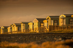 Mobile homes sunset. Prefab mobile homes lit by a warm sunset stock photo