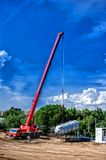 Mobile industrial crane installing a concrete and cement plant Stock Photography