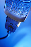 Mobile internet. Cell phone in blue light Stock Photos