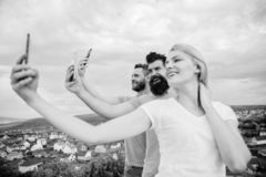 Mobile internet social networks. Mobile dependency problem. Bloggers team. Girl and man with mobile smartphones. Mobile internet social networks. Mobile stock images