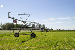 Mobile irrigation and fertilize the plants. Photo on mobile, self-propelled unit for irrigation of large area stock images