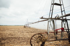 Mobile irrigation pivot watering a field Royalty Free Stock Photography