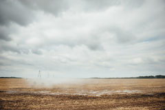 Mobile irrigation pivot watering a field Royalty Free Stock Image