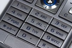 Mobile keyboard. Close up of silver mobile phone keyboard Royalty Free Stock Photography