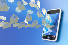 Mobile mail. Messages flying into a mobile phone. Hi-res digitally generated image Stock Photography