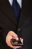 Mobile in man hand. Mobile communication. Closeup. Royalty Free Stock Photography