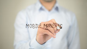 Mobile Marketing, man writing on transparent screen stock photos