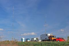 Mobile meteorological station working on the road in the natural environment. Car camp specialist diagnostics. Weather forecast an royalty free stock photography