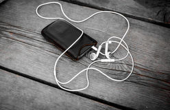 Mobile Music Player. With white headphones Royalty Free Stock Images