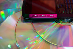 Mobile musical cell phone and  color disks Royalty Free Stock Image
