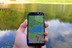 Mobile navigation near lake Stock Image