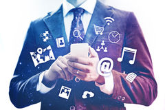 Mobile network device concept. Business man using mobile device concept Royalty Free Stock Photos