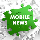 Mobile News on Green Puzzle. Royalty Free Stock Photo