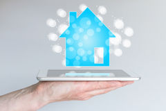 Mobile and online real estate and property sales with smart phone and tablet. Royalty Free Stock Photo