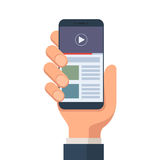 Mobile online video. Human hand holding smartphone with online video hosting on the screen.  Mobile video streaming technologies. Vector illustration in flat Stock Images