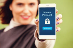 Mobile payment app. Woman holding a smart phone with secure payment app in the screen Royalty Free Stock Photography