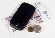 Mobile payment. Cell Phone and Russian money Stock Image
