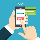 Mobile payment concept. Hand holding a phone. Smartphone wireles Stock Photo