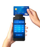 Mobile payment concept, Hand holding Smartphone with processing of mobile payments. From credit card Royalty Free Stock Image