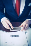 Mobile payment. Man paying bills with mobile phone scanning barcode Royalty Free Stock Photos