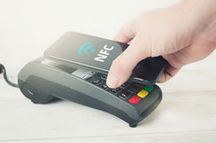 Mobile payment with smart phone. Royalty Free Stock Photo