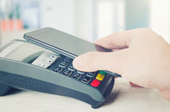 Mobile payment with smart phone. Royalty Free Stock Images