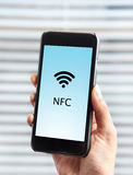 Mobile payment using NFC. Mobile payment using a cellphone equipped with NFC Royalty Free Stock Images