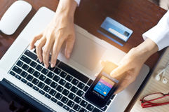 Mobile payments, man using mobile payments and credit card for online shopping Stock Images
