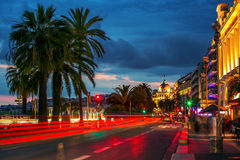 Mobile people and stable buildings through the night at Nice Fra. Night View from Nice, France - Mobile people and stable buildings Stock Image