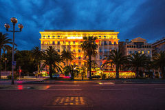 Mobile people and stable buildings through the night at Nice Fra Royalty Free Stock Photos