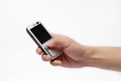 Mobile phone. Hold by a right hand Royalty Free Stock Image
