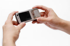 Mobile phone. A hand holding a mobile phone for support Royalty Free Stock Photo