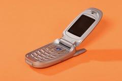 Mobile phone. On the orange background Stock Image