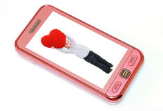 Mobile phone. With young baby with red heart Stock Photos