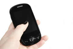 Mobile phone. Women's hand with black mobile phone Royalty Free Stock Images
