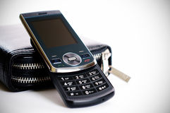Mobile phone. Elegant mobile phone and a male bag for documents Stock Photography