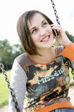 Mobile Phone. Smiling Teenager speak on Mobile Phone royalty free stock images