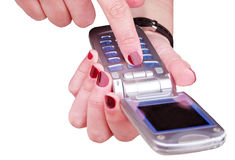 Mobile phone. Woman hands using a mobile phone-over white Royalty Free Stock Photography