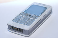 Mobile Phone. A white and silver Mobile Phone royalty free stock images