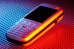 Mobile phone. Mobile smart phone on high tech color background Royalty Free Stock Image