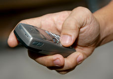 Mobile Phone. A close up of a hand holding a mobile phone equipped stock photography