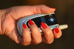 Mobile Phone. Women holding a mobile phone Royalty Free Stock Photo