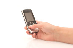 Mobile phone. Woman hand holding mobile phone isolated on white Royalty Free Stock Images
