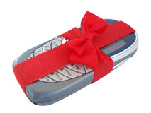 Mobile phone 2. A mobile phone with a red bow. A beautiful present Royalty Free Stock Photos