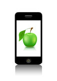 Mobile phone. Mobile phone and ripe apple green are shown in the picture Royalty Free Stock Photo