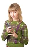 Mobile phone. Portrait of the girl who are dialing the number on mobile phone Royalty Free Stock Photography
